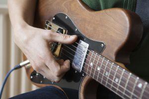 Guitar harmonics being played
